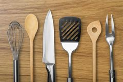 Kitchen utensil. Wire whisk spatula rolling pin spoon kitchen knife work tool Stock Image