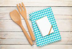 Kitchen utensil and notepad over wooden table Stock Photo