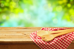 Kitchen utensil over garden background Stock Image