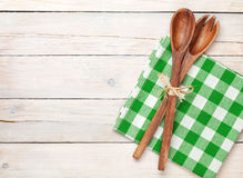 Kitchen utensil over white wooden table background. View from above with copy space Royalty Free Stock Images