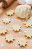 Kitchen utensil with raw Christmas cookies Stock Photos