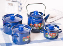 Kitchen utensil set of blue pots and kettle Royalty Free Stock Image