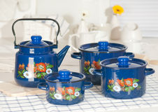 Kitchen utensil set of blue pots and kettle Royalty Free Stock Photos