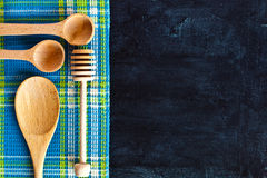 Kitchen utensil and tablecloth Royalty Free Stock Image