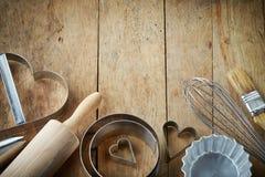 Kitchen utensil. Various kitchen utensils on wooden table Stock Image