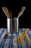 Kitchen utensils. Three kitchen utensils made of wood in a metalic container Royalty Free Stock Image