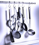 Kitchen Utensils. Rack of kitchen utensils hanging on the wall Royalty Free Stock Images