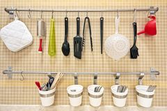 Kitchen utensils. Against a tiled wall Stock Photography