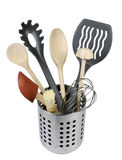 Kitchen utensils. A set of kitchen utensils and cooking tools, including wooden spoons, a pasta holder and a whisk Stock Images