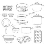 Kitchen utensils for baking. A set of dishes for baking: frying pan, saucepan, a colander. Molds for cupcakes Stock Photography