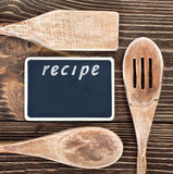 Kitchen utensils and a blackboard to write a recipe Royalty Free Stock Photo
