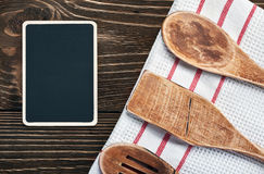 Kitchen utensils and a blackboard to write a recipe Stock Photography
