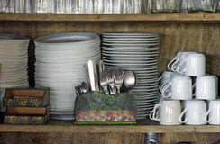 Kitchen utensils in cabinet of popular restaurant Stock Photography