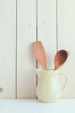 Kitchen utensils in ceramic jug Royalty Free Stock Photos
