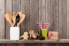 Kitchen utensils and christmas spices on shelf Stock Photography