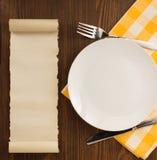 Kitchen utensils at cloth napkin on wood Stock Photo