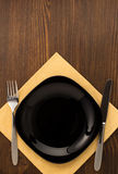 Kitchen utensils at cloth napkin on wood Royalty Free Stock Photos