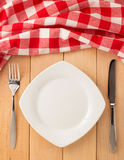 Kitchen utensils and cloth napkin on wood Stock Image