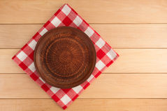 Kitchen utensils at cloth napkin on wood Royalty Free Stock Photo