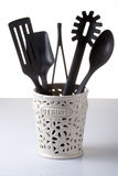 Kitchen utensils. In container on white and gray background Stock Photo