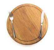 Kitchen utensils at cutting board Stock Photos