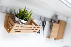 Kitchen utensils and decor hanging on the white wall Stock Photos