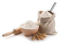 Kitchen utensils, ears, flour in a bowl and bag isolated Stock Images