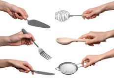 Kitchen utensils in the hands,  collage. Kitchen utensils in the hands of women isolated on white background collage Royalty Free Stock Image