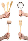 Kitchen utensils in the hands,  collage Stock Photo