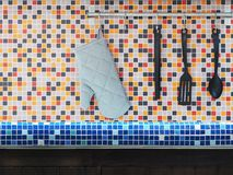 Free Kitchen Utensils Hanging Over Colorful Mosaic Wall Tiles. Royalty Free Stock Photos - 102976188