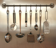 Kitchen utensils hanging on wall Royalty Free Stock Photos