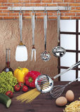 Kitchen utensils hanging. On the wall Royalty Free Stock Photography