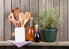 Kitchen utensils, herbs and spices on shelf Stock Photo