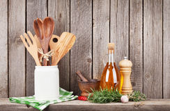 Kitchen utensils, herbs and spices on shelf royalty free stock images