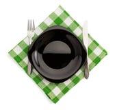Kitchen utensils at napkin on white Royalty Free Stock Images