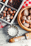 Kitchen utensils and nuts Stock Photos
