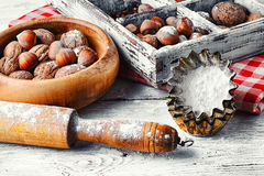 Kitchen utensils and nuts Royalty Free Stock Image