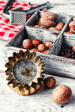 Kitchen utensils and nuts Royalty Free Stock Images