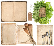 Kitchen utensils, old cookbook, pages and herbs Royalty Free Stock Images