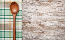 Kitchen utensils on the old wood background Stock Image