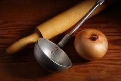 Kitchen utensils and onion Stock Photo