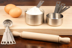 Kitchen utensils over wood Royalty Free Stock Photo