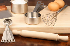 Kitchen utensils over wood Royalty Free Stock Image