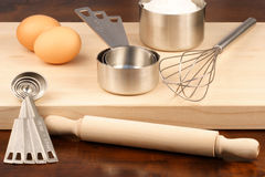 Kitchen utensils over wood Stock Images