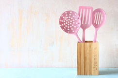 Kitchen utensils over wooden textured background Royalty Free Stock Images