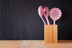 Kitchen utensils over wooden textured background Stock Images