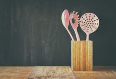 Kitchen utensils over wooden textured background Royalty Free Stock Image