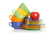 Kitchen utensils, plates and cups on a white Royalty Free Stock Photo