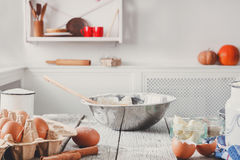 Kitchen utensils, products for dough, baking. Kitchen utensils, baking ingredients . Products for cooking dough on white wooden table in rustic kitchen, blurred Stock Image
