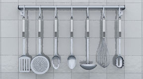 Kitchen utensils on a rack Royalty Free Stock Image